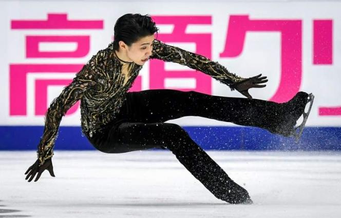 Two-time Olympic Champion Hanyu Survives Fall To Win In