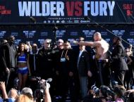 Wilder vows to knock out Fury at heavyweight title weigh-in