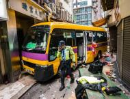 Two killed as Hong Kong school bus mounts pavement, trapping pass ..