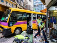 Four killed as Hong Kong school bus mounts pavement, trapping pas ..