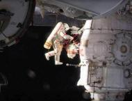 Russian spacewalkers take sample of mystery hole at space station ..