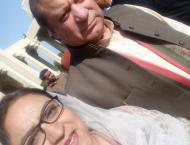 Nawaz Sharif presents flower to female party member outside court ..