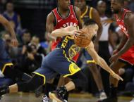 Durant, Curry lead Warriors over Grizzlies