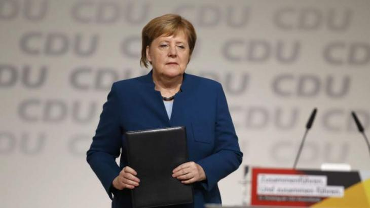 Merkel defends legacy as divided party picks new leader