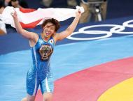 Japan wrestling star Yoshida taps out before Olympics