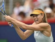 Nadal flies into Open round two as Kerber issues warning