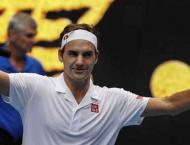 Federer and Wozniacki stay on track as Anderson crashes
