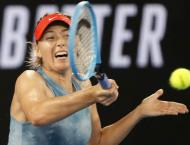 Sharapova stuns Wozniacki as ice man Federer ploughs on