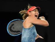 Sharapova upsets defending champion Wozniacki