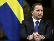 Swedish lawmakers elect PM Lofven to second term