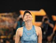 Sharapova stuns Wozniacki as ice men Nadal and Federer plough on