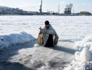 Russians dive into icy waters on Epiphany