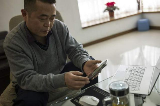 China's first 'cyber-dissident' faces trial