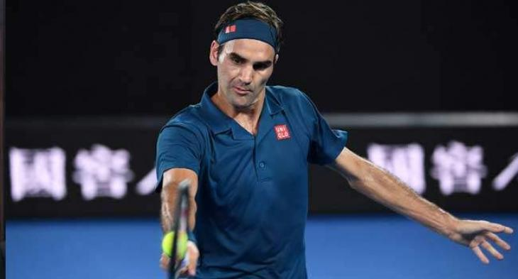 Cool Federer sweeps into Open round two