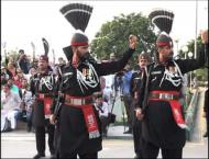 Hundreds participate in flag-lowering ceremony at Wagha