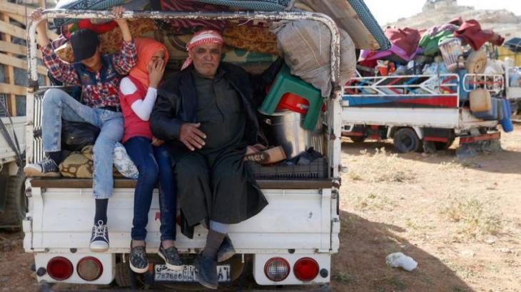 About 870 Syrian Refugees Return Home From Abroad Over Past 24 Hours - Russian Military