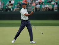 Woods climbs to world no. 6, Johnson retakes top spot