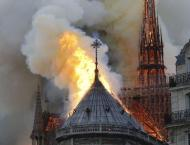 France's Iconic Notre Dame Cathedral Partially Destroyed by Fire  ..