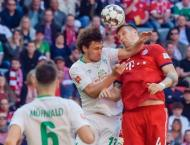 Bayern grind out Bremen win to stay ahead of Dortmund