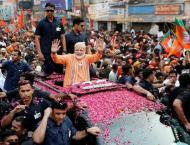 Thousands greet Modi election roadshow in Indian holy city