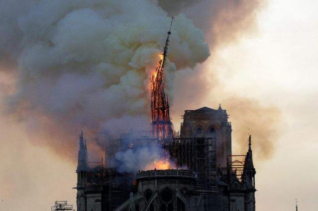 Workers questioned over Notre-Dame inferno as donations pour in