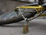 Woman killed as her scarf entangled in bike