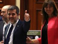 Catalan jailed MPs attend Spain parliament opening
