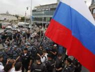 Two Russian Newspapers Say Several Reporters Detained at Unsancti ..