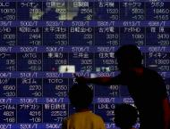 Asian markets edge up as trade fears persist