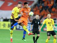 Penalty drama as Chinese giants Evergrande reach Asia's last eigh ..