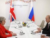 May to Putin: Stop 'destabilising' UK, allies