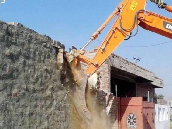 50 shops, houses demolished in anti-encroachment operation in Peshawar