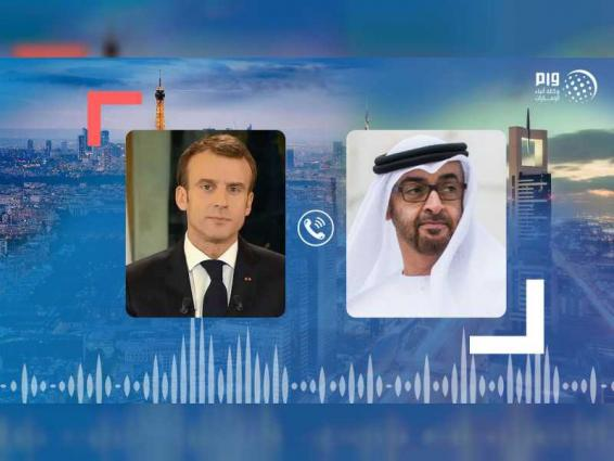 Mohamed bin Zayed, French President reviewing regional developments