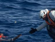 Migrant rescued swimming Channel with rubber ring, flippers