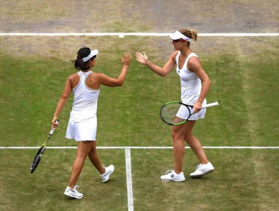 Xu and Dabrowski knock out defending Wimbledon champions