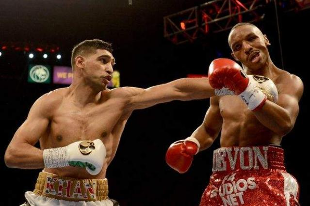 Amir Khan defeats Billy Dib to claim WBC int'l welterweight title