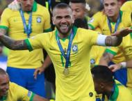 Brazil captain Alves heads home to Sao Paulo