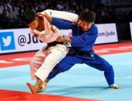 Judo's coming home: clinical Japan bag world double