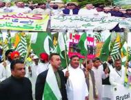 KP Governor, CM lead a big rally to express solidarity with Kashm ..