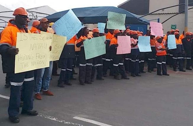 John seeks reinstatement of sacked workers