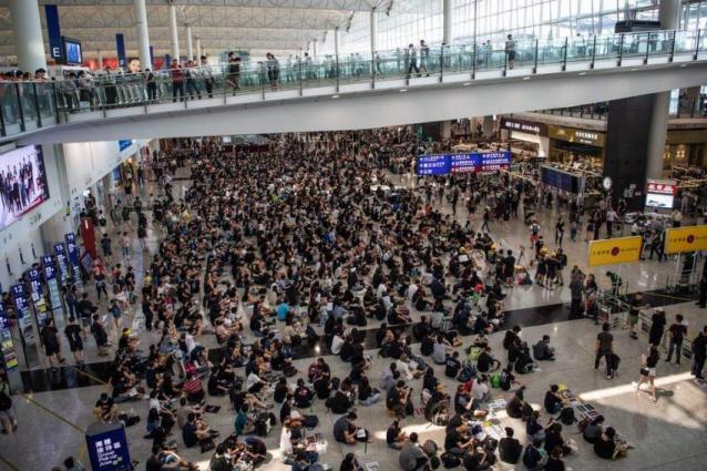 Hong Kong Protesters Defend Airport Chaos