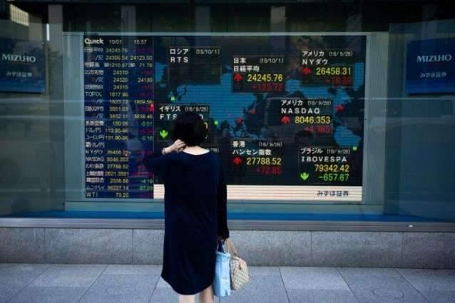 Tokyo stocks end marginally higher