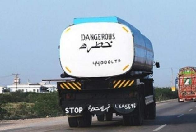 Inflammable Chemical filled oil tanker seeps at motorway