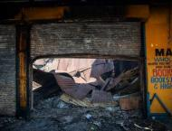 S.Africa police say two charred bodies found in Johannesburg stor ..