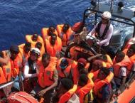 New Italy government lets rescued migrants disembark