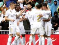 Real Madrid hang on for win after Benzema brilliance