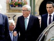 UK Prime Minister, EU chief agree Brexit talks must 'intensify'