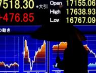 Tokyo shares gain on US rate cut, as BoJ holds policy line