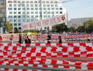 German govt reaches 100 bn euro climate plan deal as protests hea ..