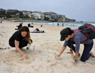 Environmental activists pluck plastic from world's beaches on mas ..